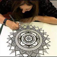 Lady Drawing a Mandala