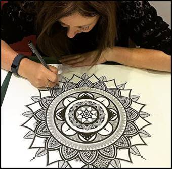 Lady Drawing a Mandala